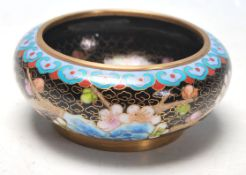 A 20th Century Chinese Cloisonne dish of round from having enamelled decoration throughout depicting