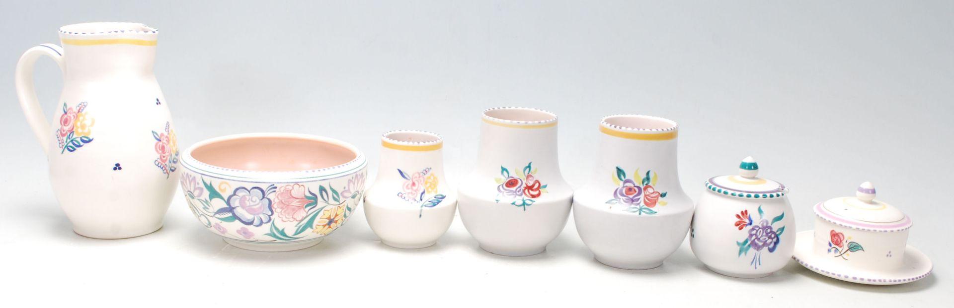Los 22 - A group of seven vintage Poole Pottery items comprising; a jug, bowl, pair of vases, sugar bowl,