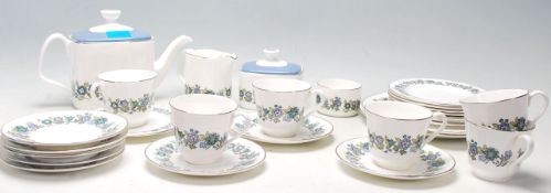 A vintage retro 20th Century Royal Doulton fine bone china tea service comprising of cups,