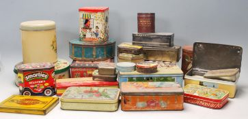 A large collection of vintage mid 20th Century metal advertising tins, biscuits tins, tobaccos