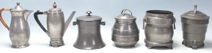 A good collection of hand beaten Liberty style Art and Crafts pewter items to include three tea