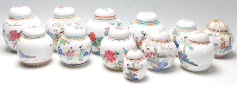 A collection of 20th Century Chinese republic period ginger jars decorated with famille rose