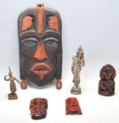A collection of oriental religions figurine to include Chinese Wise Man, brass Thai Teppanom