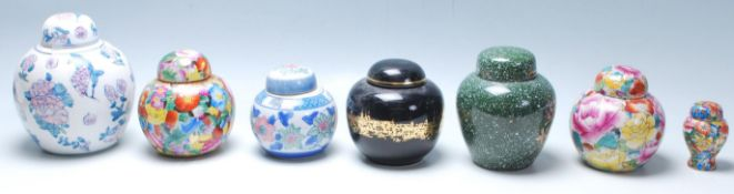 A group of 20th Century Chinese ginger jars of various styles to include blue and white floral