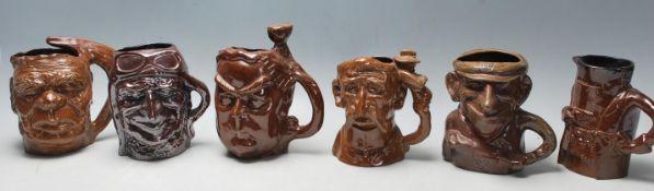A group of six Australian Bendigo studio art ceramic pottery limited edition character mugs to