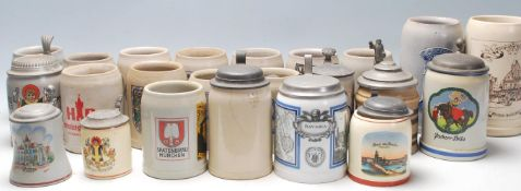 A large collection of 20th Century German blue and grey stoneware jugs and beer steins all having