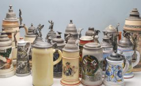 A collection of 20th Century German ceramic stein drinking glasses, each having raised polychrome