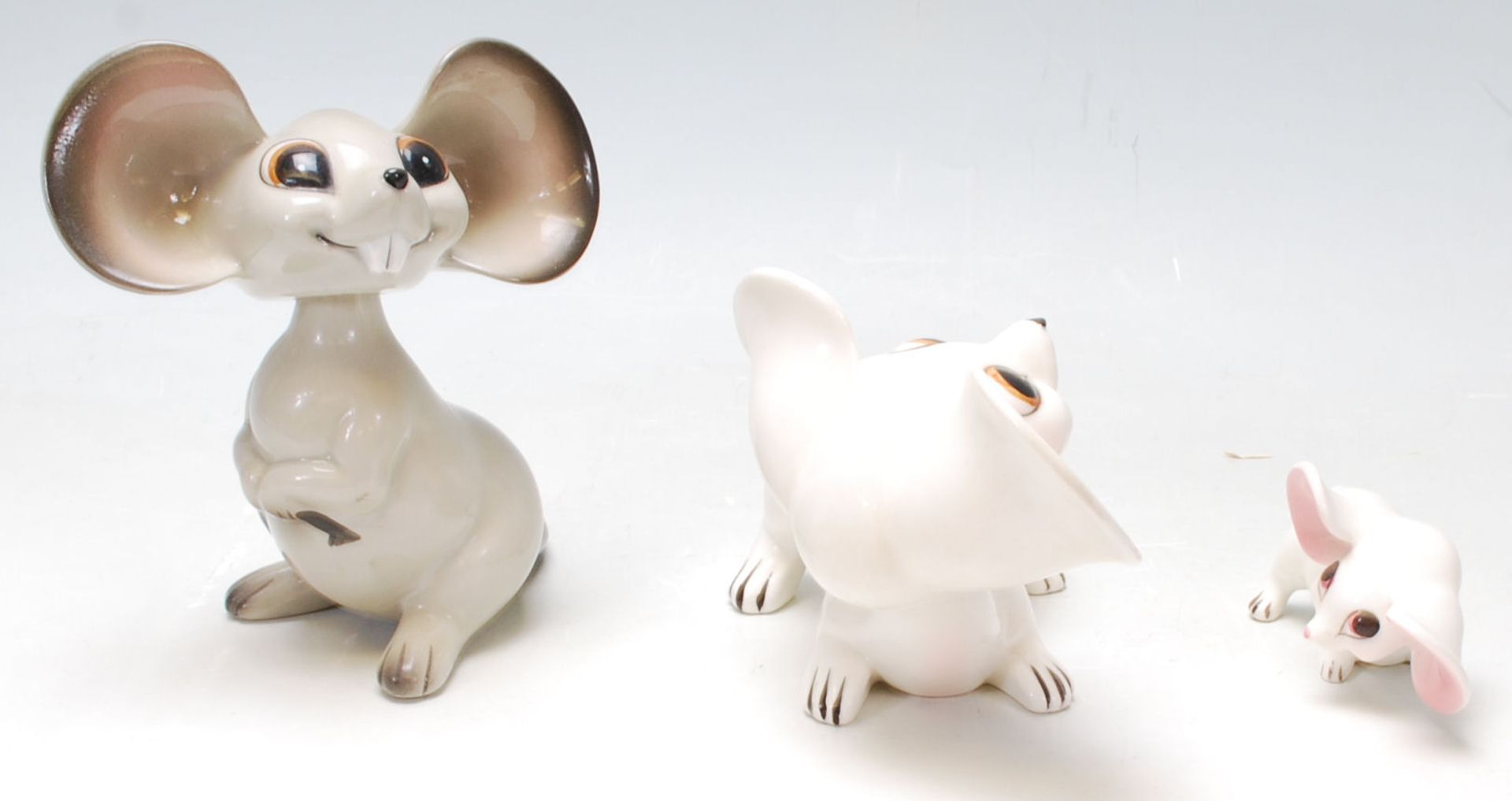 Los 16 - A group of 1960's vintage German ceramic mice comprising of a pair of white and pink mice sitting on
