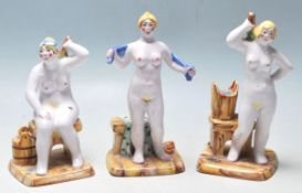 A group of three 20th Century ceramic Russian figurines depicting three stylised nudes ladies each
