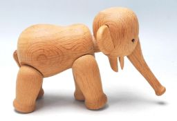 A 1960's Danish teak wood articulated elephant by Kay Bojesen, with an articulated trunk, black