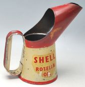 A vintage 1950's Shell Rotella Oil jug having a large beak, oval shaped handle, finished in red
