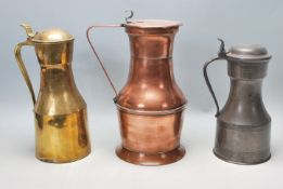 A good collection of three late 19th Century / early 20th century jugs to include a pewter example