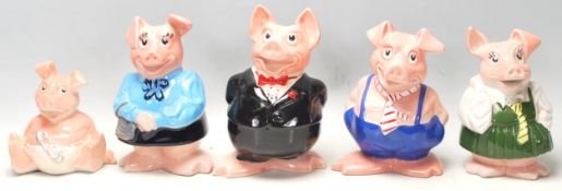 A set of five vintage Wade made NatWest bank advertising / savings / money box pigs. Unboxed, but
