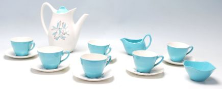 A mid century Midwinter Modern Fashion Shape blue and white coffee set having floral decoration to