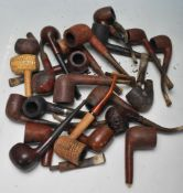 A collection of 15+ early & late 20th century tobacco pipes to include London made examples,
