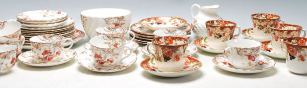 Two vintage English china tea sets to include eight Victorian tea cup trios, creamer jug and creamer