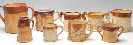 A large quantity of 19th century Royal Doulton Lambeth stoneware to include cups, jugs and loving