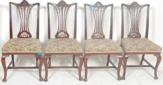 A set of four early 20th Century Edwardian dining chairs in the manner of hepplewhite having pierced