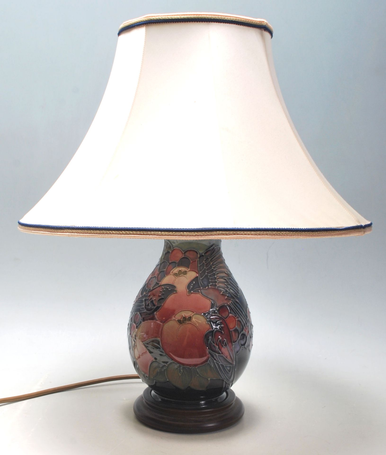 Los 2 - A 20th Century Moorcroft finches pattern table lamp of baluster form being decorated with tube lined