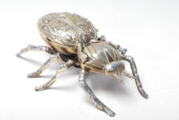 An retro vintage mid 20th century Tobacciana Italian brass and metal ashtray in the form of a beetle