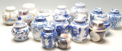 A collection of fifteen 20th Century Chinese blue and white printed ginger jars to include a good