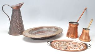 A collection of early 20th Century Art Nouveau copper and brass items to include a Joseph Sankey &