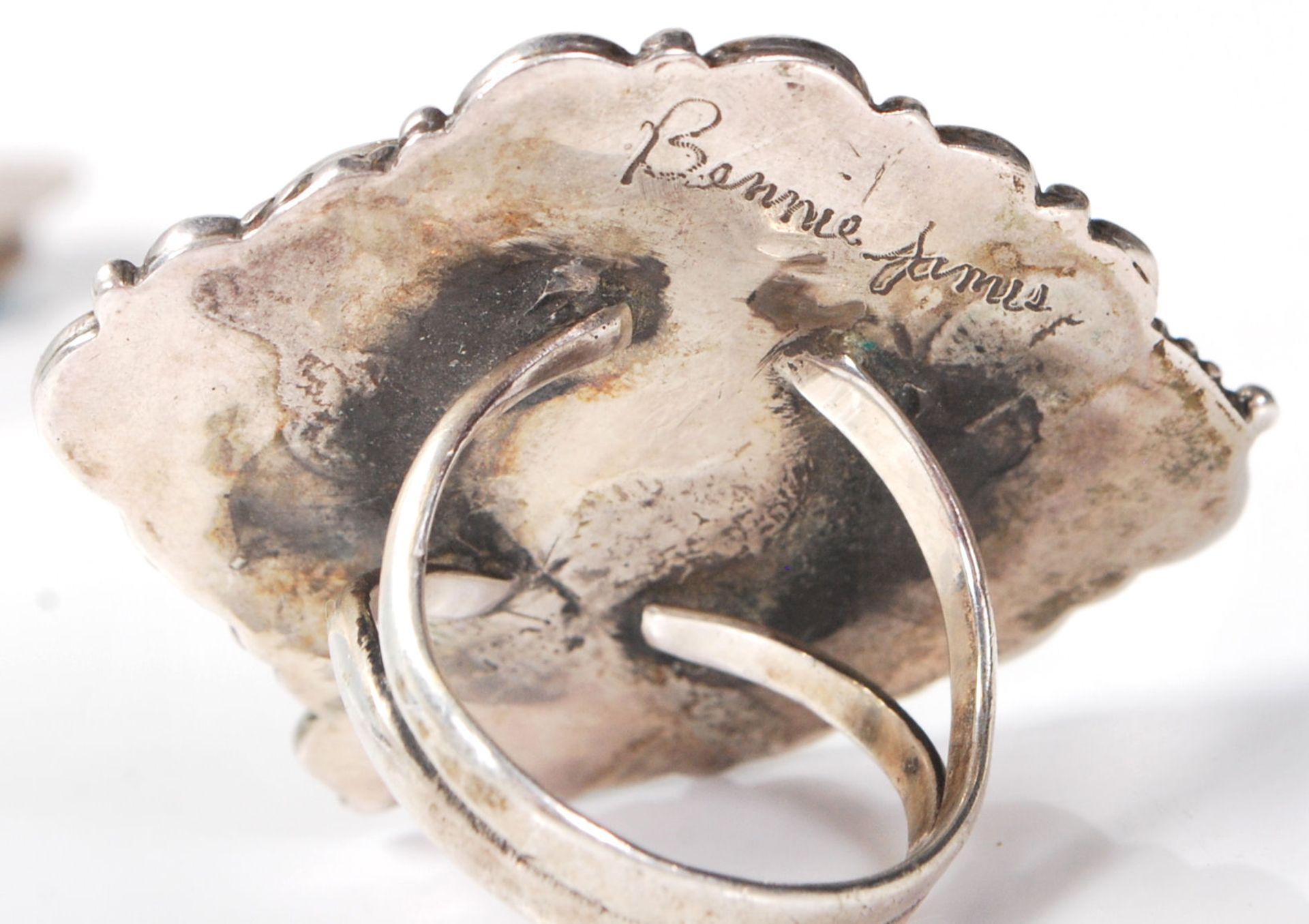 Los 760 - Two silver Navajo / Zuni Native American signed rings to include one signed by N Lee having a