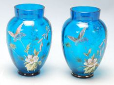 A pair of 19th Century Victorian Aesthetic Movement hand painted blue glass vases having a ribbed