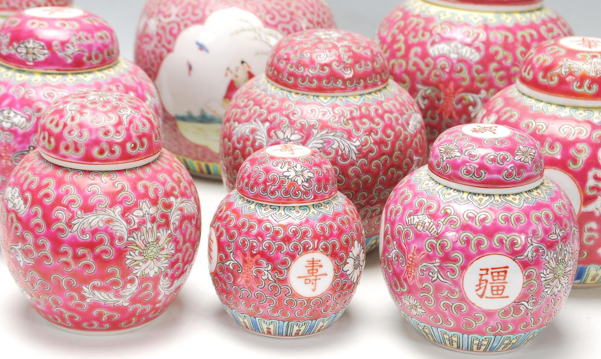 Los 126 - A collection of thirteen 20th Century Chinese famille rose ginger jars being decorated with red
