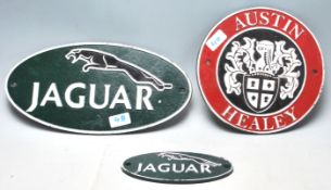 A collection of three 20th Century vintage style cast iron Classic Car related shop display /