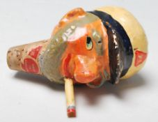 A vintage retro novelty oil pourer / bottle stopper in the form of a smoking sailor having hand