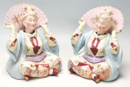 A large pair of Victorian German porcelain nodding figurines in the manner of Meissen, circa 1900
