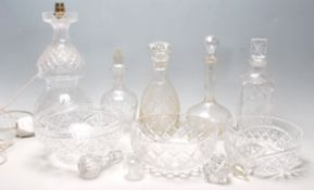 A collection of 20th Century cut glass items to include two large cut glass centrepiece bowls,