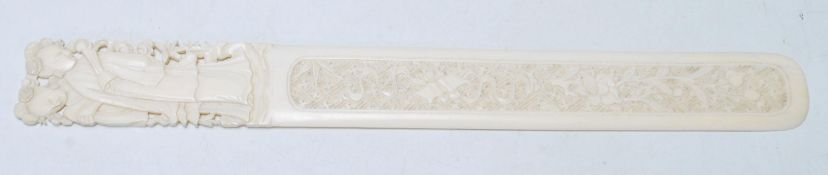 An early 20th Century Chinese ivory letter opener with a carved and pierced handle decoration