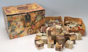 A late 19th century Victorian paper mache decorated box housing a Victorian wooden block puzzle