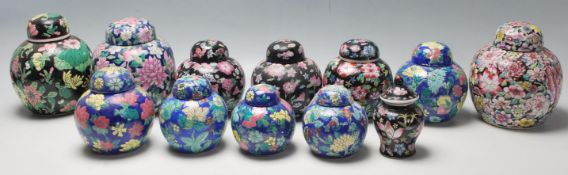 A collection of twelve 20th Century Chinese ginger jars all having hand enamelled floral sprays