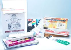 A collection of artist paints and materials to include artists paper, gouache paint, oil paints,