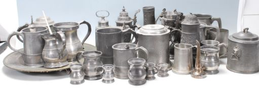A substantial collection of 20th Century German pewter drinking / mugs / flagons / steins, each
