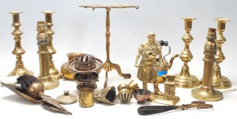 A collection of 20th Century brassware to include four knopped candlesticks, a trivet with pierced