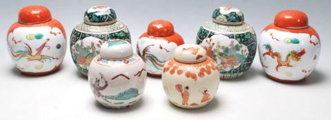 A collection of seven 20th Century Chinese porcelain ginger jars to include two famille verte floral