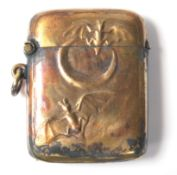 A vintage 20th Century brass vesta case decorated with a crescent moon and bats in flight. Striker