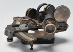 A 20th Century brass ships sextant having a wooden handle with a sighting telescope and horizon
