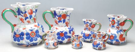 A group of seven early 19th Century graduated Mason patent Ironstone China jug having colourful