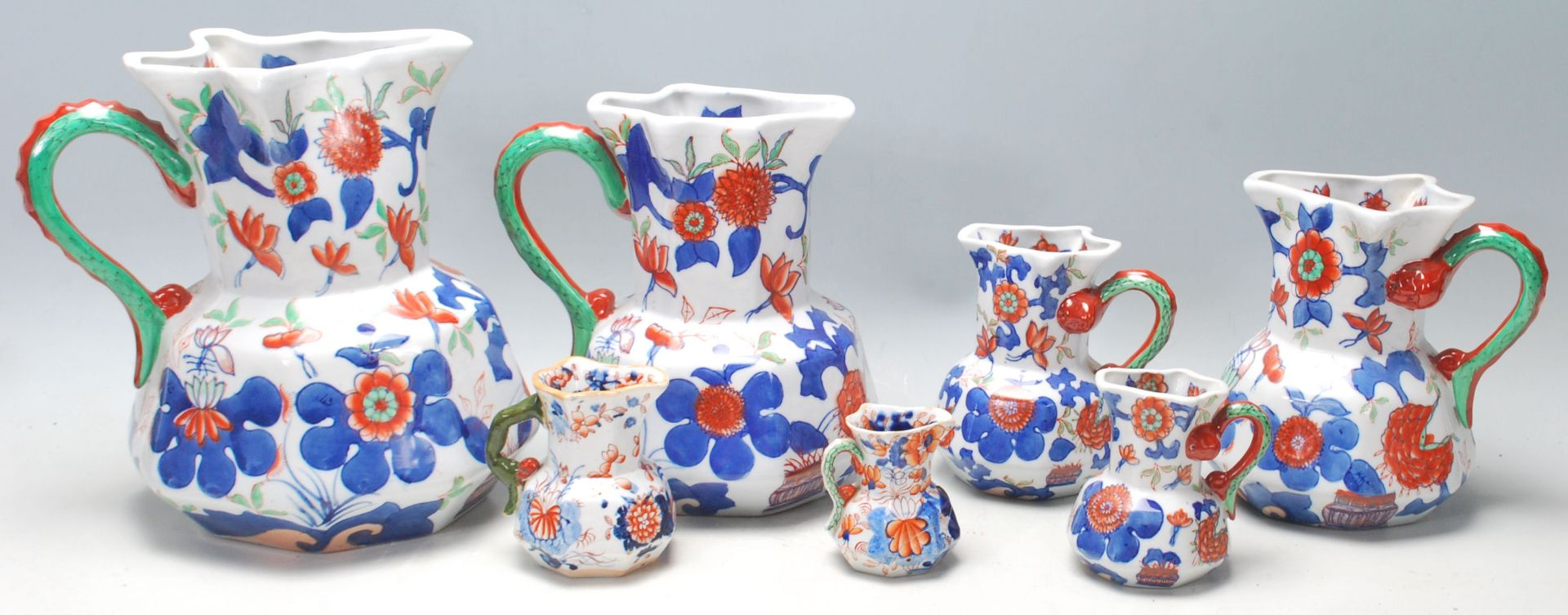 Los 4 - A group of seven early 19th Century graduated Mason patent Ironstone China jug having colourful