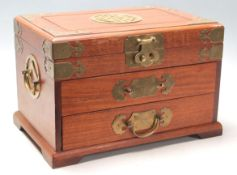 A vintage 20th Century Chinese wooden jewellery compartment box having a hinge lid to the top with