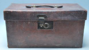 An Antique 20th Century Leather trunk / doctors / Gladstone bag of square form with a makers mark
