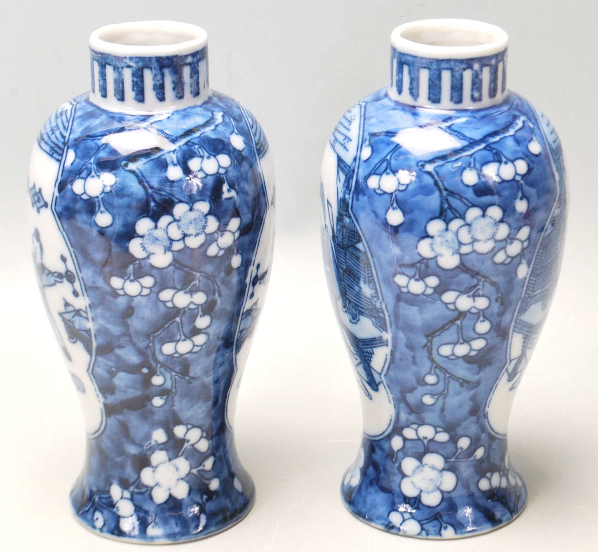 Los 177 - A true pair of 20th Century Chinese Kangxi vases of baluster form with decorated with plum