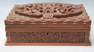 A vintage 20th Century finely carved fruitwood jewellery box having bird and floral decoration