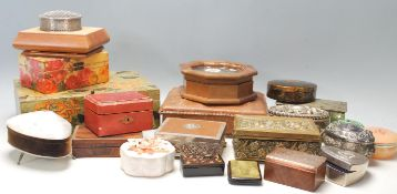 A large collection of vintage jewellery boxes to include wooden examples, white metal with relief
