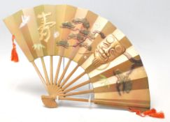 A 20th Century Chinese cast bronze wall mounting fan ornament having raised gilt and cold painted